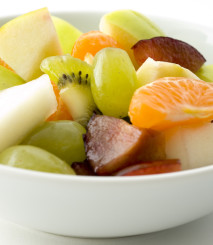 a photo of a Fruit salad close up in a bowl