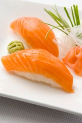 a photo of salmon nigiri on a plate