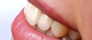 closeup of smiling woman's mouth and teeth