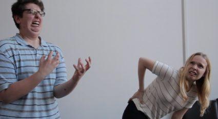 improv team members performing a scene