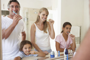 Brushing together helps teach good oral hygiene